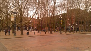 Occidental Park in Pioneer Square.  Here the homeless often gather under the shadow of the much-needed $430-million Centurylink Field, home of the Centurylink Seahawks.
