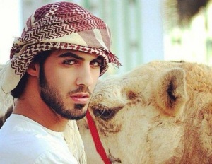 "This is Omar Bourkan Al Gala with a camel.  He calls this look ""Blue Steel.""  Photo from huffingtonpost.com"